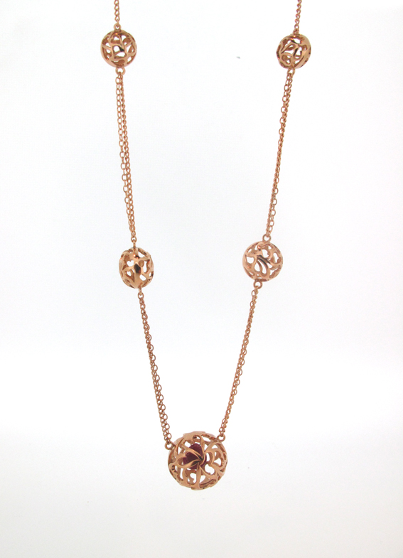 Rose gold-plated,multi-ball,cut-out heart pendant with ruby