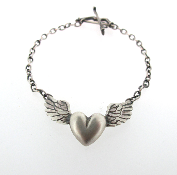 Oxidised silver, winged-heart bracelet with bow & arrow clasp