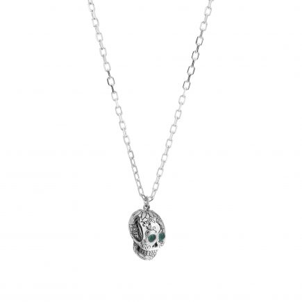 Silver sugar skull pendant set with cabachon emeralds