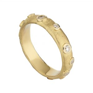 18ct yellow gold and round rubover-set round diamond Molten eternity ring