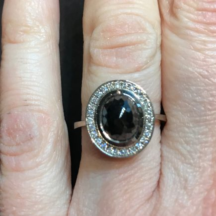 18ct white gold and black rose-cut diamond and white diamond halo ring