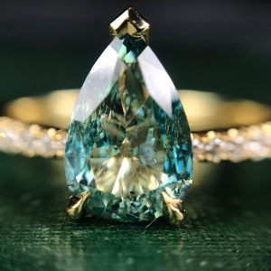 18ct yellow gold and pear shaped blue diamond ring