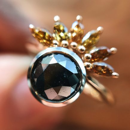 Limited edition 18ct rose gold, black and orange diamond Sun-ray ring