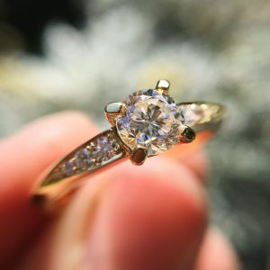 18ct yellow gold Coco engagement ring claw-set with a 0.50pt round white diamond