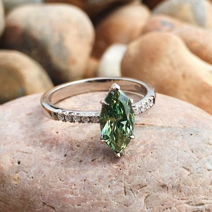 18ct white gold and treated green marquise diamond engagement ring