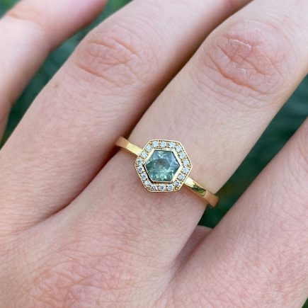 18ct yellow gold hexagon Montana sapphire Halo ring