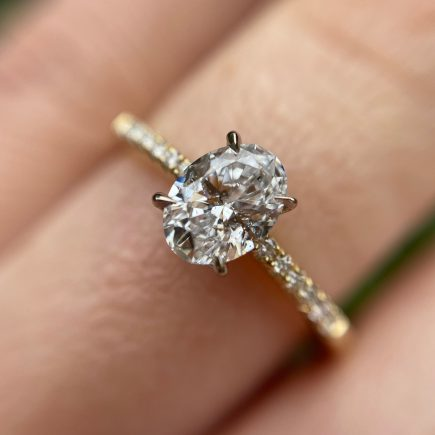 18ct yellow gold and oval white diamond engagement ring with diamond-set shoulders