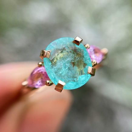 18ct rose gold Paraiba Tourmaline Coco Trilogy engagement ring with pink sapphire shoulders