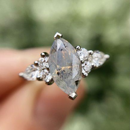 Platinum Unicorn Marquise Diamond Ring with White Diamond shoulder detail