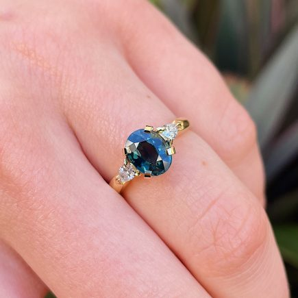 18ct Yellow Gold Teal Sapphire Coco Trilogy Ring with Diamond Shoulders